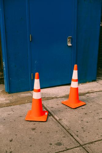 TWO HATS. Transport Traffic infrastructure Street Lanes & trails Road sign Traffic cone Container Signs and labeling Orange Arrangement Colour photo