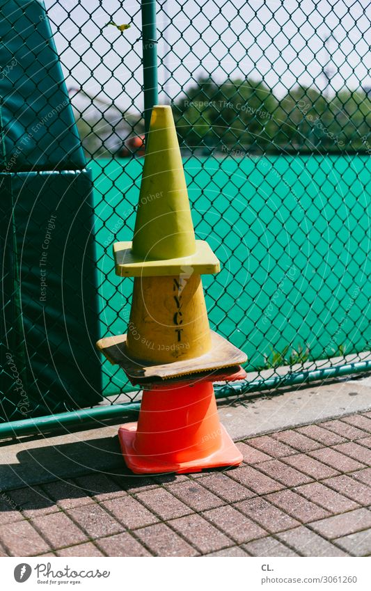 Yellow Lanes & trails Playing Orange Leisure and hobbies Characters Arrangement Safety Fence Sporting event Stack Road sign Sporting Complex Traffic cone
