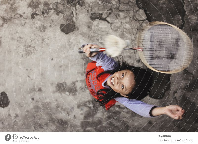 Girl Jumping Playing Badminton Human being Child 1 8 - 13 years Infancy Athletic Sports Colour photo Exterior shot Aerial photograph Copy Space right Evening