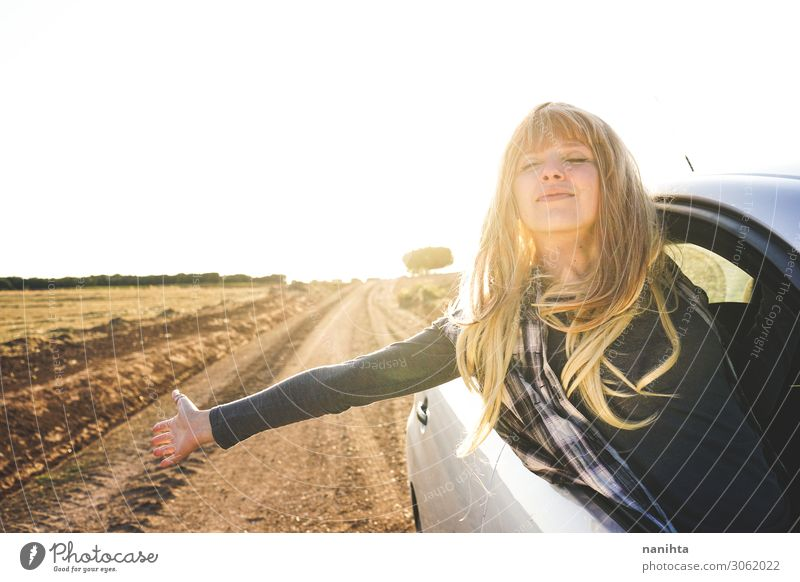 Young woman in a road trip enjoying the journey Lifestyle Style Vacation & Travel Tourism Trip Adventure Far-off places Summer Human being Feminine