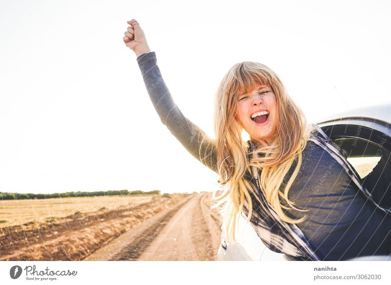 Young woman in a road trip enjoying the journey Lifestyle Style Joy Happy Wellness Well-being Vacation & Travel Tourism Trip Adventure Far-off places Summer