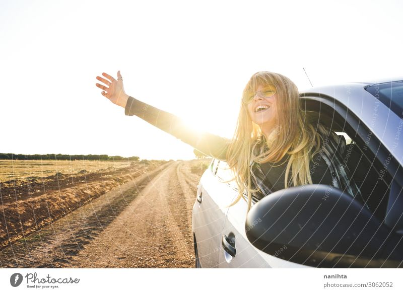 Young woman in a road trip enjoying the journey Woman Human being Sky Vacation & Travel Summer Beautiful White Joy Far-off places Healthy Street Lifestyle