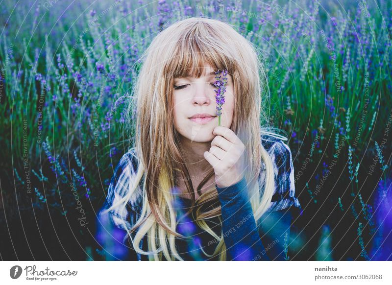 Young woman enjoying the day in a field of lavender Woman Human being Youth (Young adults) Beautiful Flower Relaxation Face Lifestyle Adults Natural Feminine