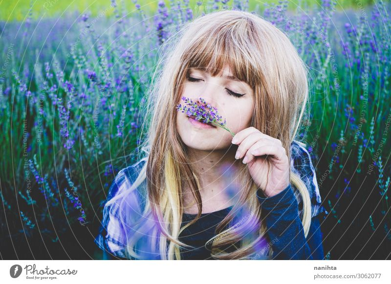 Young woman enjoying the day in a field of lavender Woman Human being Nature Youth (Young adults) Summer Plant Beautiful Green Flower Relaxation Healthy