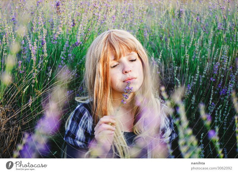 Young woman enjoying the day in a field of lavender Herbs and spices Lifestyle Beautiful Face Cosmetics Alternative medicine Medication Relaxation Human being