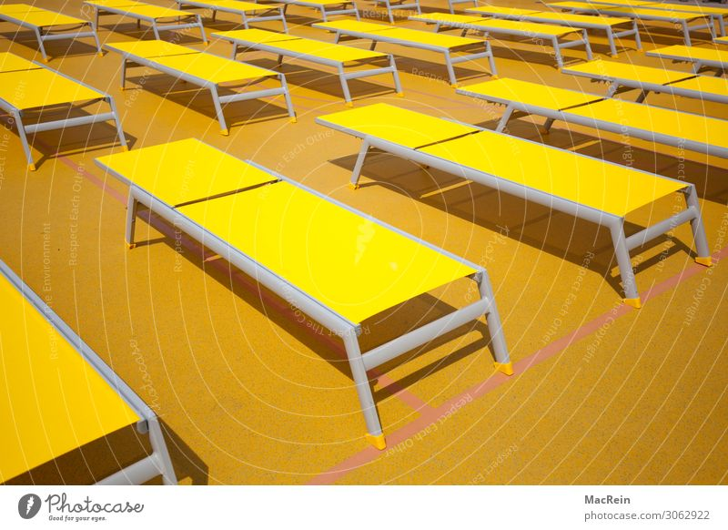 sunbeds Relaxation Calm Vacation & Travel Tourism Cruise Summer Sun Lie Yellow Deckchair Beaded Side by side Behind one another Deserted Colour photo