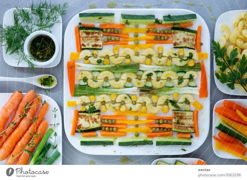 Square pasta salad with fried spring onions and zucchini Lettuce Noodles Food Vegetable Salad Dough Baked goods Herbs and spices Cooking oil Carrot Pepper