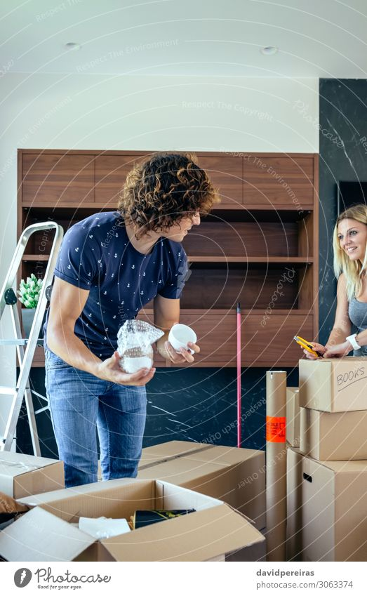 Couple unpacking moving boxes Lifestyle Happy Beautiful Flat (apartment) House (Residential Structure) Moving (to change residence) Living room Human being