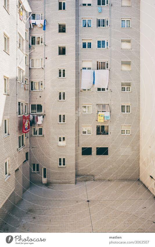 Blue Town White Red House (Residential Structure) Window Yellow Wall (building) Wall (barrier) Facade Bright Door High-rise Dry Laundry Courtyard