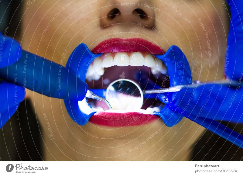 Periodic comprehensive dental examination Woman Human being White Adults Health care Open Mouth Clean Teeth Mirror Lips Tool Examinations and Tests Dentist