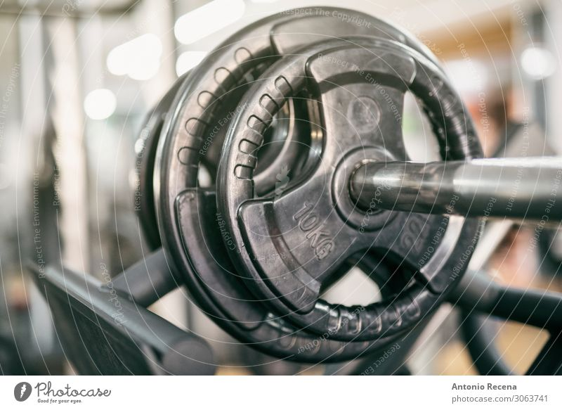 weights on exercise machine press close up, in club Relaxation Fitness Dark Power Gymnasium Practice work out fitness gym Barbell Heavy Story interior inside
