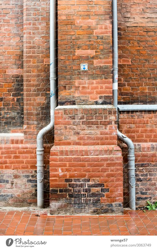 Two rainwater pipes at a listed church made of red brick somewhere in northern Germany Church Brick Brick facade Brick wall Close-up Rainwater pipes Downspout
