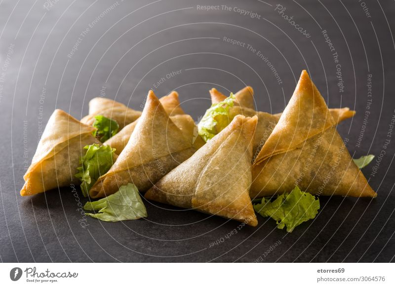 Samsa or samosas with meat and vegetables on black background. samsa Vegetarian diet Food Healthy Eating Food photograph Indian Tradition Meat Vegetable Beef