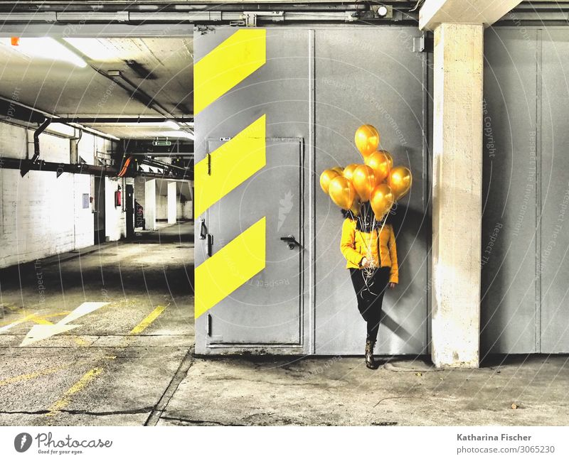 yellow balloons 1 Human being Parking garage Sign Signs and labeling Signage Warning sign Graffiti Stand Illuminate Yellow Gold Gray Black White Garage