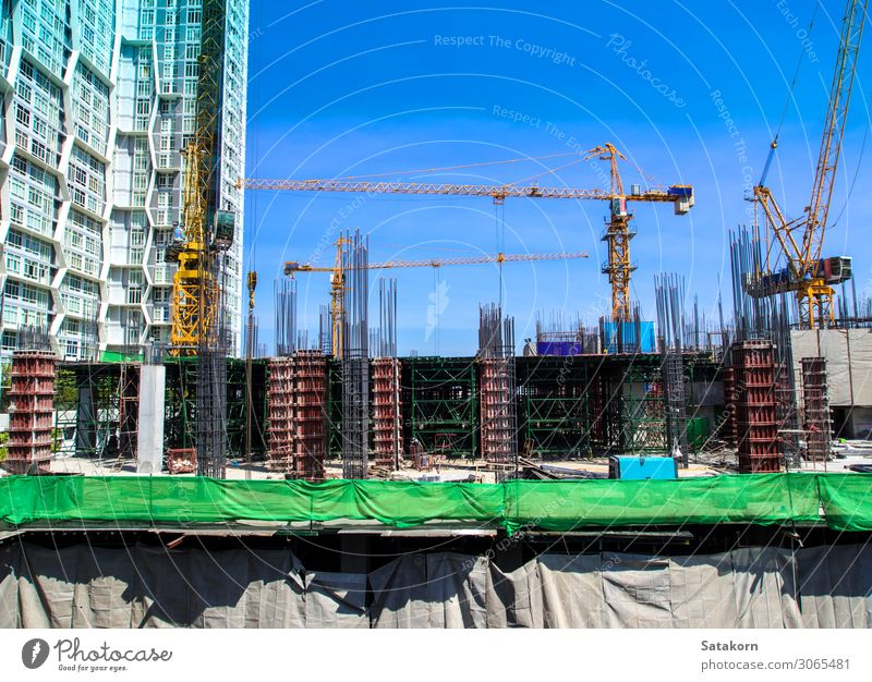 The under-construction building at site Work and employment Construction site Industry Sky Thailand Town Building Concrete Steel Blue crane Height engineering