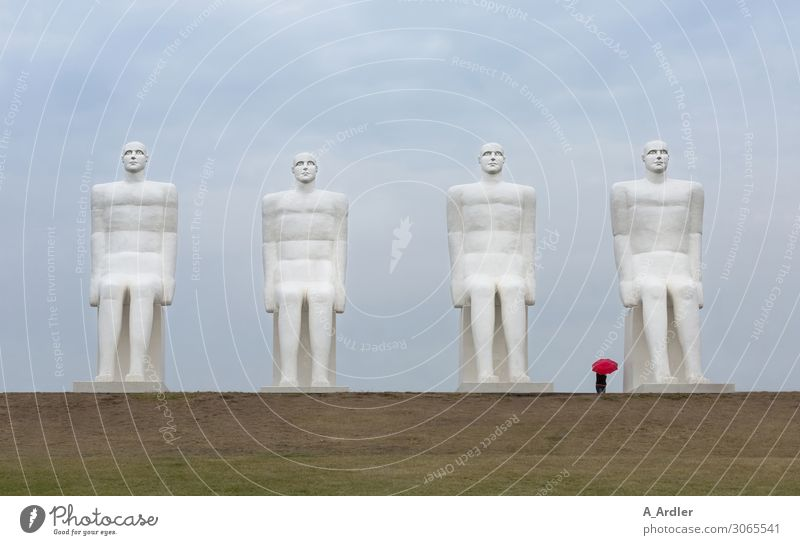 Four oversized human figures with red umbrella Art Work of art Sculpture Culture Manmade structures Tourist Attraction Landmark Monument Man by the sea Stone