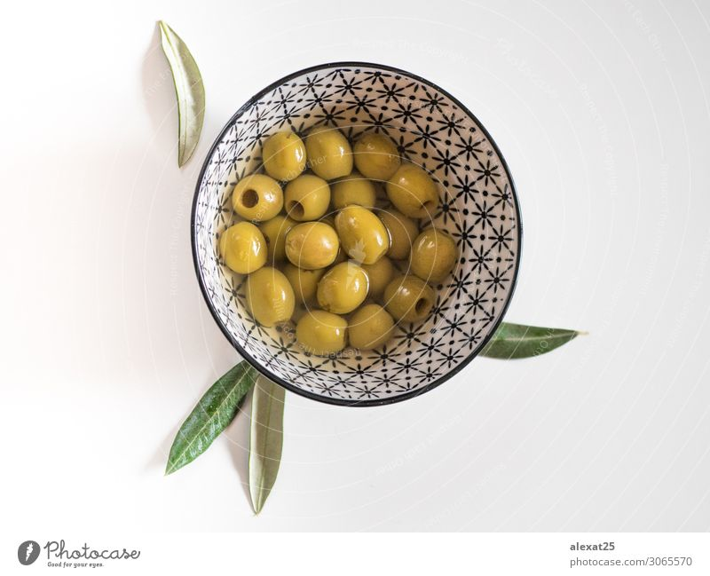 Pitted olives in a bowl on white background Vegetable Fruit Vegetarian diet Bowl Beautiful Group Nature Plant Leaf Fresh Delicious Natural Green White Berries