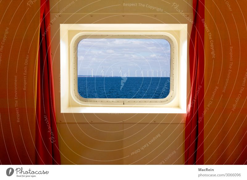 Sky Vacation & Travel Water Ocean Calm Airplane window Lake Watercraft Baltic Sea Wind energy plant Luxury North Sea Drape Cruise Porthole Passenger ship