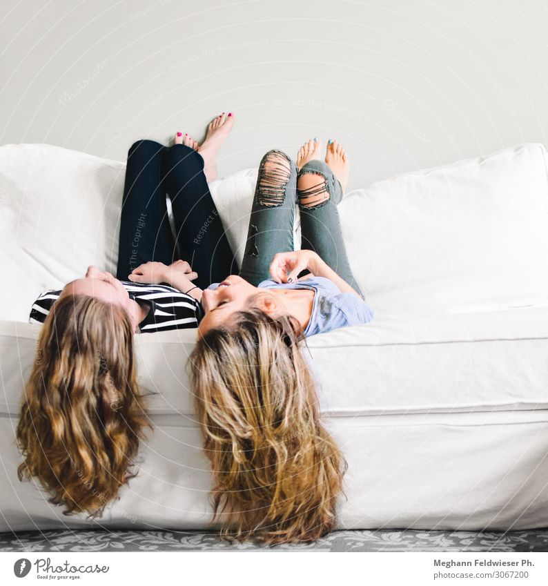 Besties Lifestyle Sofa Long-haired Hang Smiling Laughter Lie To talk Thin Friendliness Together Happy Beautiful Modern Positive Feminine Joy Happiness