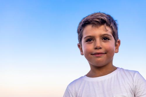Beautiful face of a little kid against the blue sky Child Human being Sky Vacation & Travel Nature Youth (Young adults) Man Summer Blue White Relaxation Joy