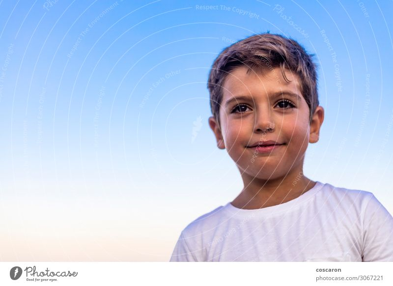 Beautiful face of a little kid against the blue sky Lifestyle Joy Happy Face Leisure and hobbies Vacation & Travel Summer Island Child Success Human being