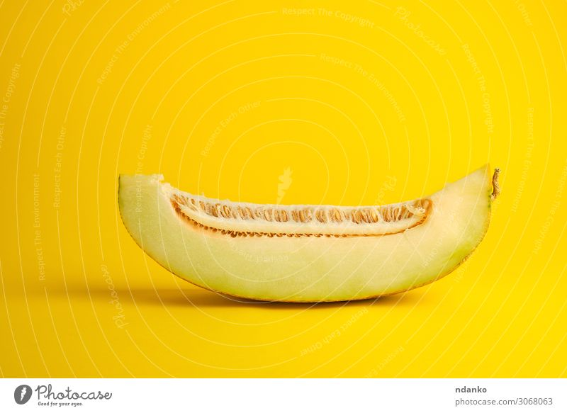 piece of ripe melon with seeds on a yellow background Vegetable Fruit Dessert Nutrition Vegetarian diet Diet Summer Nature Plant Eating Fresh Natural Juicy