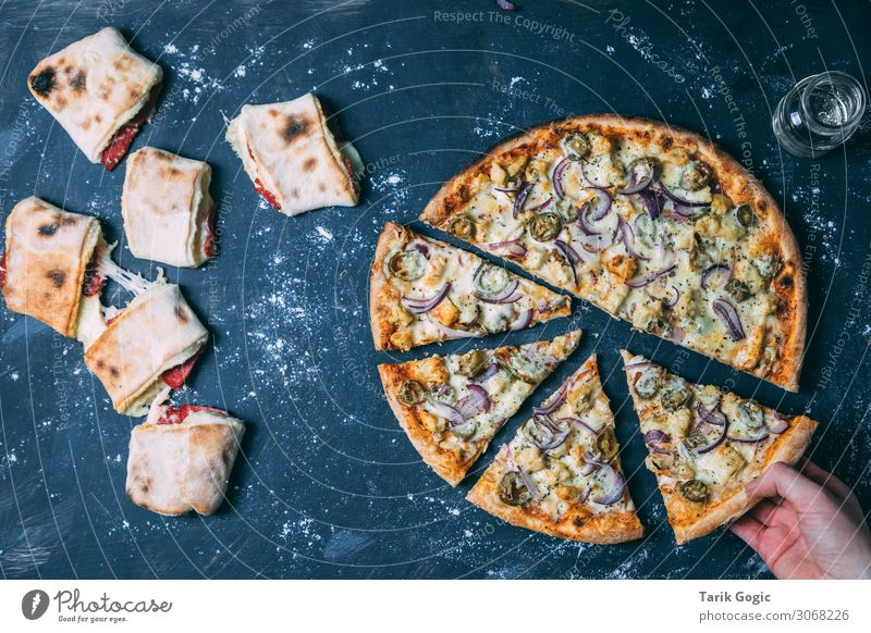 Pizza and pizza rolls on a dark background Food Dough Baked goods Cheese Coating Salami Onion Chili Nutrition Eating Lunch Dinner Fast food Finger food