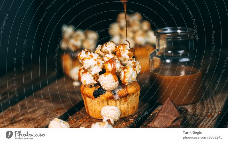 Popcorn muffins with caramel sauce and chocolate pieces Food Dough Baked goods Dessert Candy Chocolate Sugar Caramel Sauce topping Muffin Sweet Nutrition