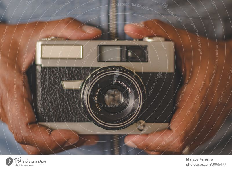 vintage photo camera in hands Lifestyle Beautiful Leisure and hobbies Decoration Camera Technology Human being Adults Hand Metal Old Retro Vantage point frame