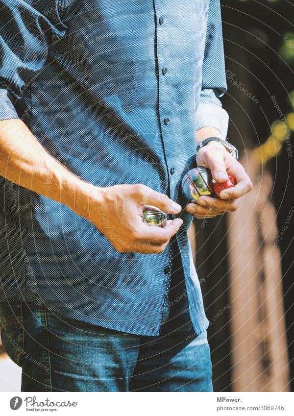 boules player Human being Hand 1 Playing Boules Sphere Upper body Summer Leisure and hobbies Stop Colour photo Exterior shot Day