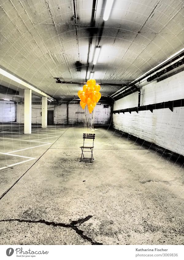 The beginning I Garage Underground garage Wall (barrier) Wall (building) Trashy Yellow Gold Orange Black White Balloon Chair Parking lot Parking lot lighting
