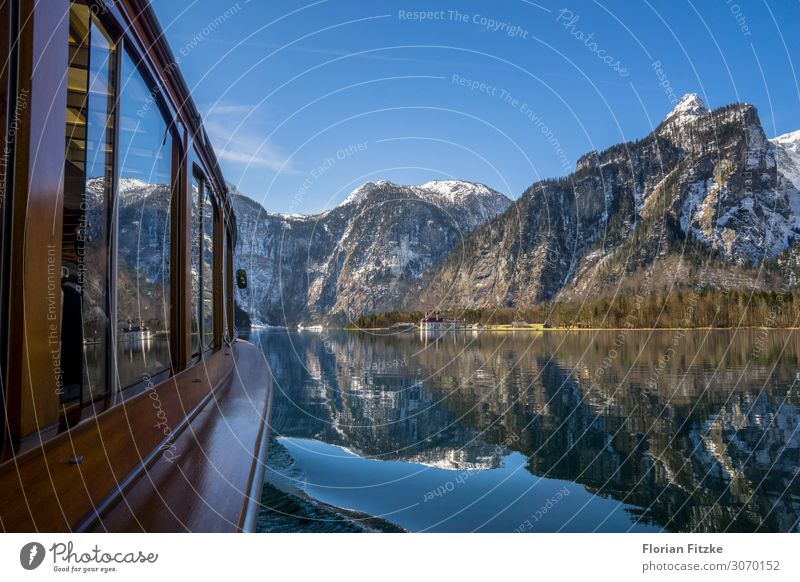A boat trip on Lake Königssee in the Berchtesgaden NP Nature Landscape Water Cloudless sky Beautiful weather Alps Mountain Peak Snowcapped peak Lakeside
