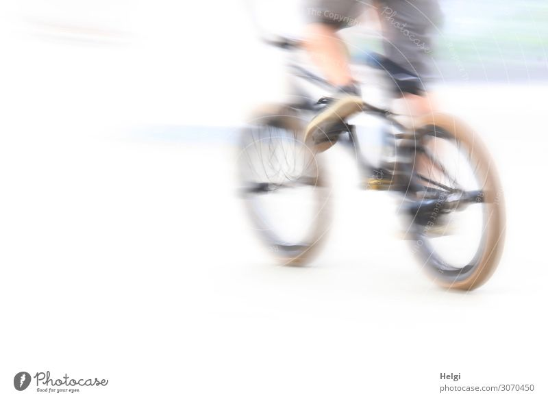 racy cyclist on the way in a sports park with motion blur Sports Cycling Bicycle Sporting Complex Human being Youth (Young adults) Legs 1 13 - 18 years Pants