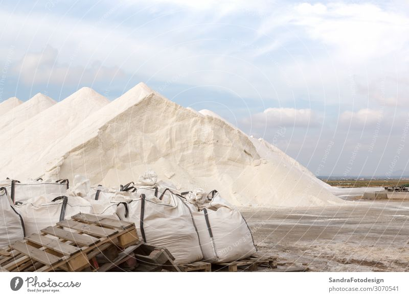 Salt hills of a salt plantation on Majorca Vacation & Travel Trip Nature Discover blue sky pans Saltworks salty mountain sea ingredient heap factory scenic view