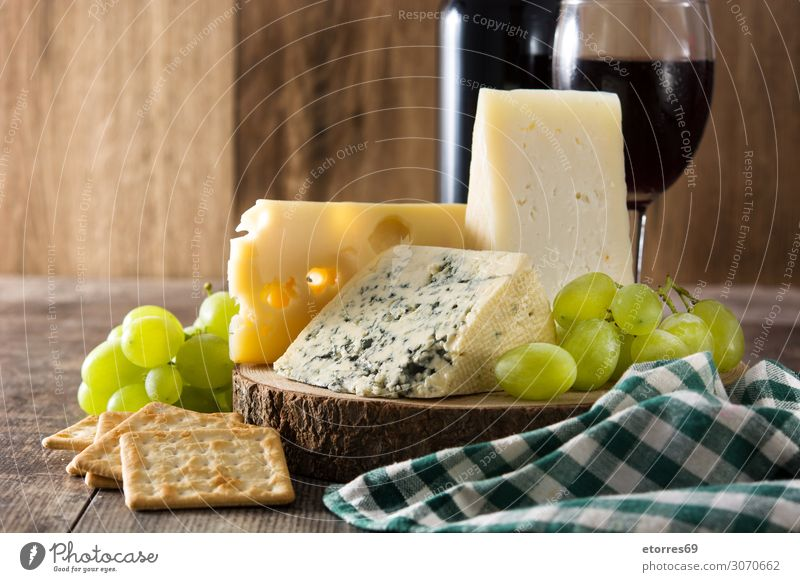 Assortment of cheeses and wine on wooden table Cheese Wine Food Healthy Eating Food photograph Beverage Alcoholic drinks assortment Wood Bottle French Gourmet