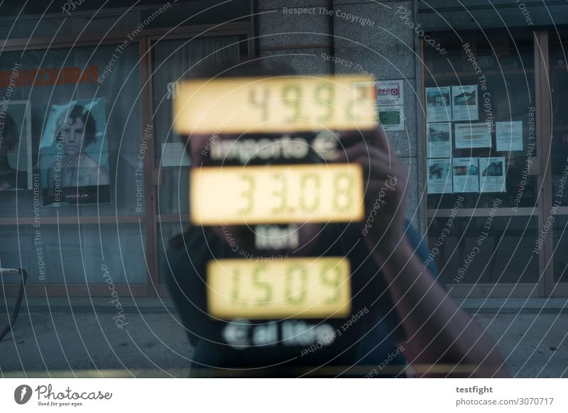petrol Masculine 1 Human being Town Pedestrian precinct Facade Environment Reflection Mirror image Refuel Petrol station Price tag Costs Colour photo