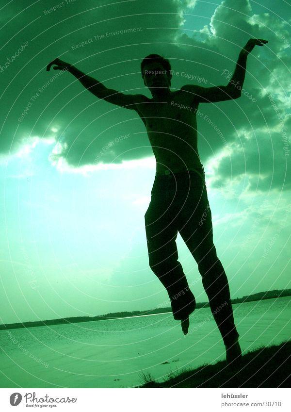 human crane Man Masculine Crane Jump Karate Green Lake Ocean Clouds Light Human being Shadow