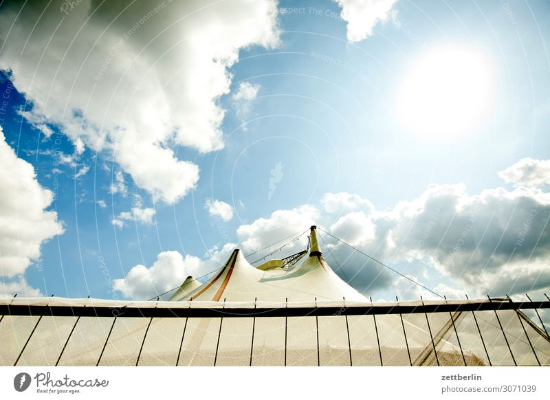 circus Sky Heaven Culture Deserted Summer Copy Space Shows Circus Circus tent Circus ring Fence Tent Clouds Worm's-eye view Sun Back-light Dazzle Flashy
