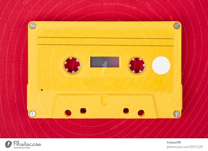 Yellow audio cassette Joy Music Technology Listen to music Media Plastic Retro Tape cassette Vintage 80s bare analogue dance isolated eighties Disco