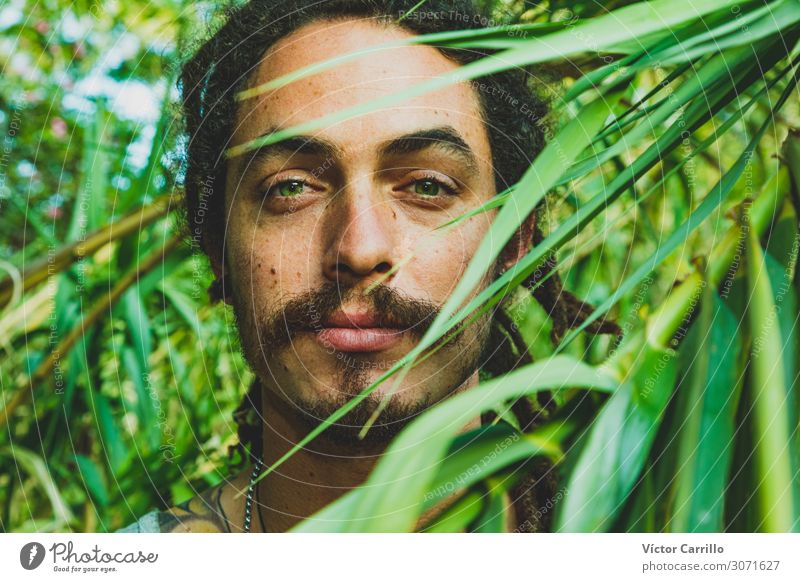 A handsome man with green eyes with a vegetation background Lifestyle Joy Happy Beautiful Relaxation Tourism Summer Beach Woman Adults Friendship
