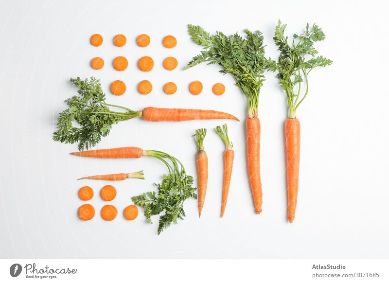 Flat lay composition with ripe fresh carrots on white background autumn cut slice table space orange agriculture vegetarian pieces isolated cutting juicy