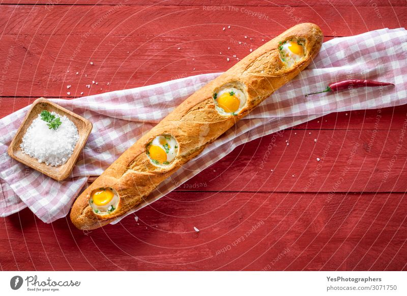 Baked eggs in baguette bread. Breakfast with eggs and loaf Dough Baked goods Roll Nutrition Buffet Brunch Healthy Eating Fresh Delicious Red above view