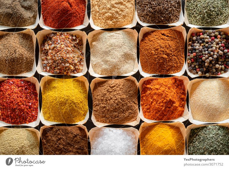 Herbs and spices in bowls background. Cooking flavors Nutrition Organic produce Vegetarian diet Collection Natural Yellow Green Red Caraway seeds above view