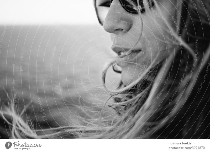 still to early to walk on lakes Feminine Woman Adults 1 Human being Sun Wind Gale Waves Coast Lakeside Beach North Sea Baltic Sea Sunglasses Hair and hairstyles