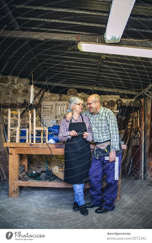 Senior couple in a carpentry Happy Leisure and hobbies Furniture Chair Profession Business Retirement Human being Woman Adults Man Couple Old Smiling Laughter