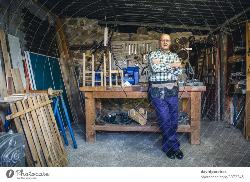 Carpenter in his workshop Craft (trade) Business Machinery Human being Man Adults Wood Old Stand Authentic Mature carpentry Posture Workbench craftsman
