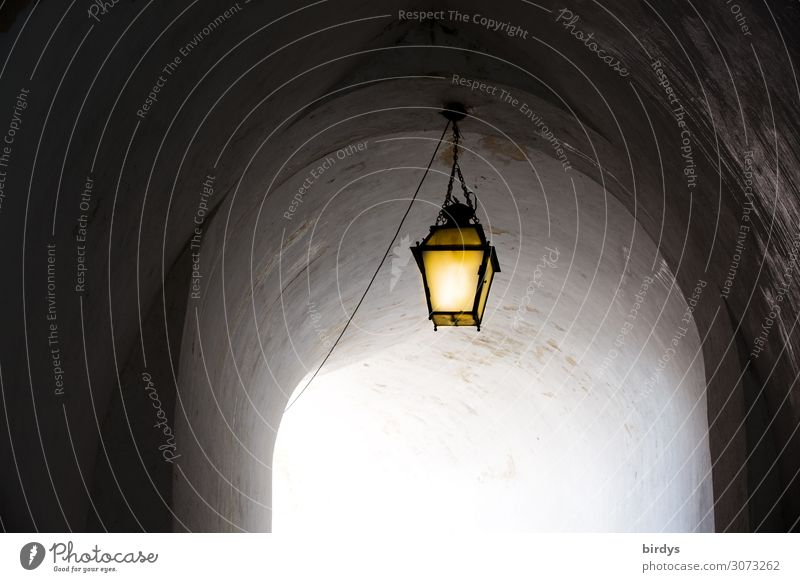 the eternal lantern Castle Tunnel Lamp Illuminate Old Esthetic Authentic Positive Yellow Gray Hope Longing End Belief Religion and faith Death Dream