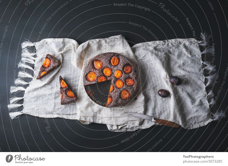 Chocolate cake with plums and dessert slices Fruit Dessert Candy Autumn Fresh above view autumn food Baking Bakery black background brownie chocolate plum cake