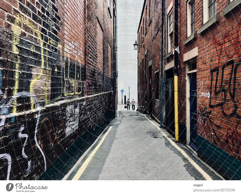 At the end of the street, Sheffield. Couple Adults 2 Human being England Town Downtown House (Residential Structure) Alley Wall (barrier) Wall (building) Facade