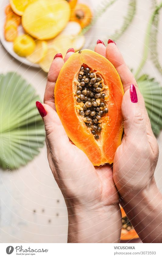 Women's hands hold half papaya with seeds Food Fruit Nutrition Breakfast Organic produce Vegetarian diet Diet Design Healthy Eating Woman Adults Hand Papaya